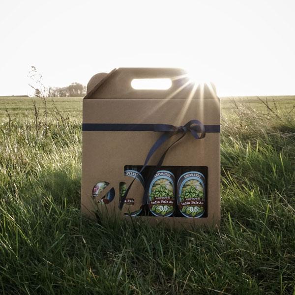 Ølkarton i naturfarvet pap til 4 flasker a 50 cl., med øl-stans